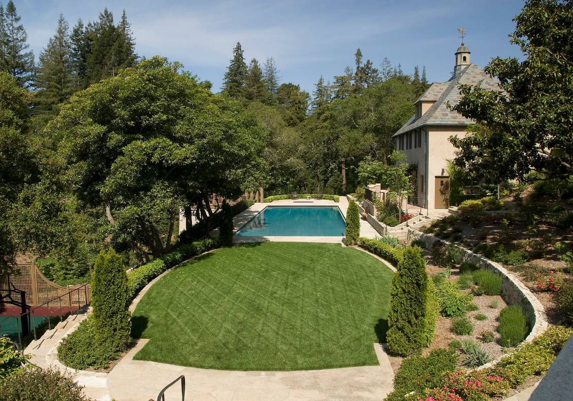 The view from the new terrace, located off the living room, which opens to the elliptical lawn, pool and pool house.