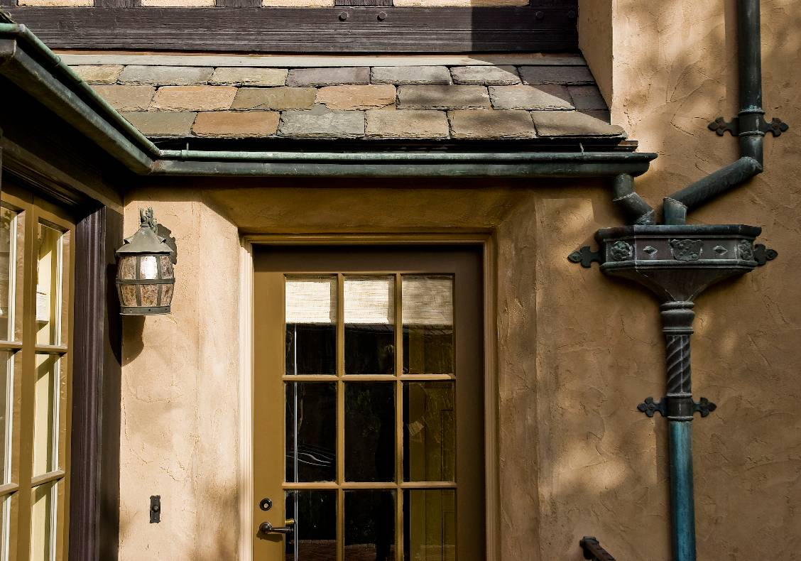 Slate roofs, verdigris copper gutters, downspouts and leader heads