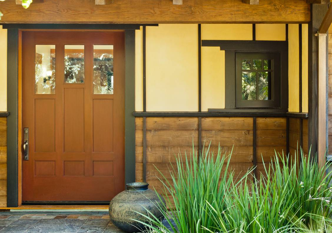 The red lacquered front door opens onto a variegated slate foyer that overlooks the courtyard.