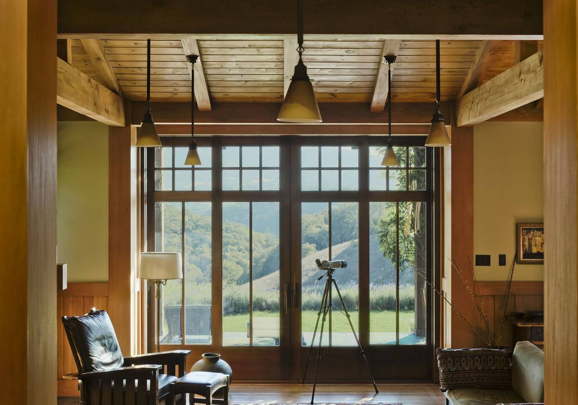 Custom-designed wood doors that slide into the walls. Stained wood ceiling and hickory/pecan flat-sawn hardwood floors, slightly distressed.