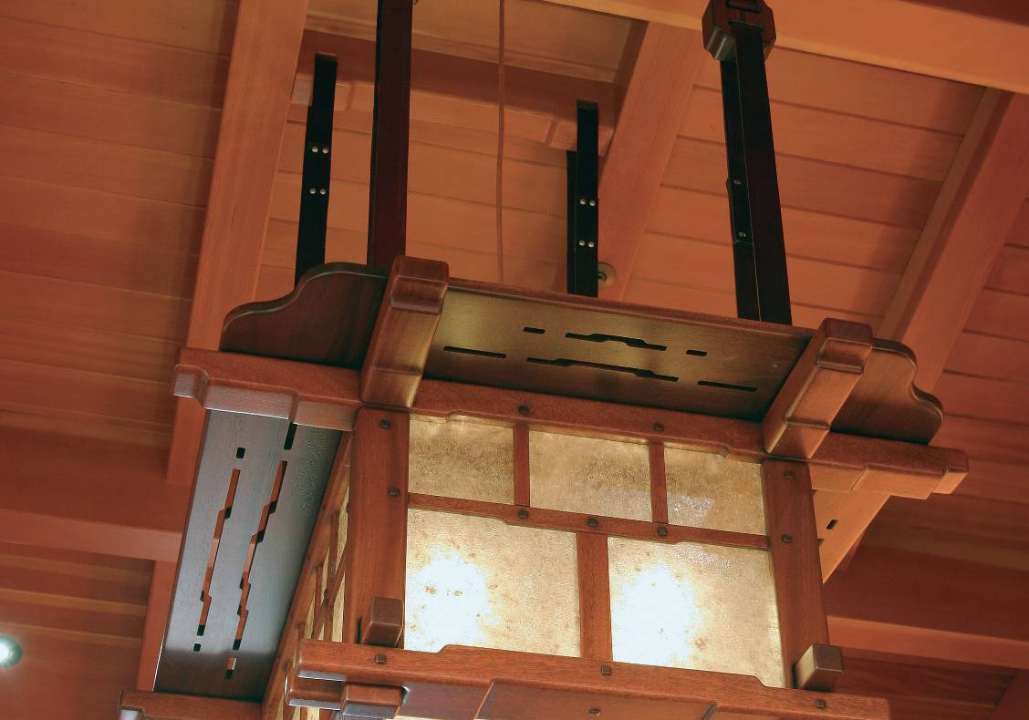 Custom designed by the architect, this mahogany, black walnut, leather and mica lantern was crafted with lap joints, mortise and tenon joints.  Two such lanterns hang in the great room of the house.