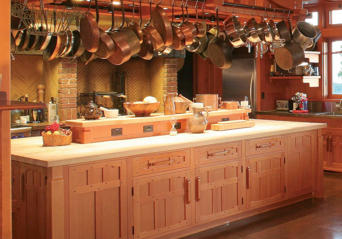 The kitchen was designed for the owners who are well known chefs and features a large work island with a generous heavy timber pot rack above and a separate cooking hearth for spit roasting.