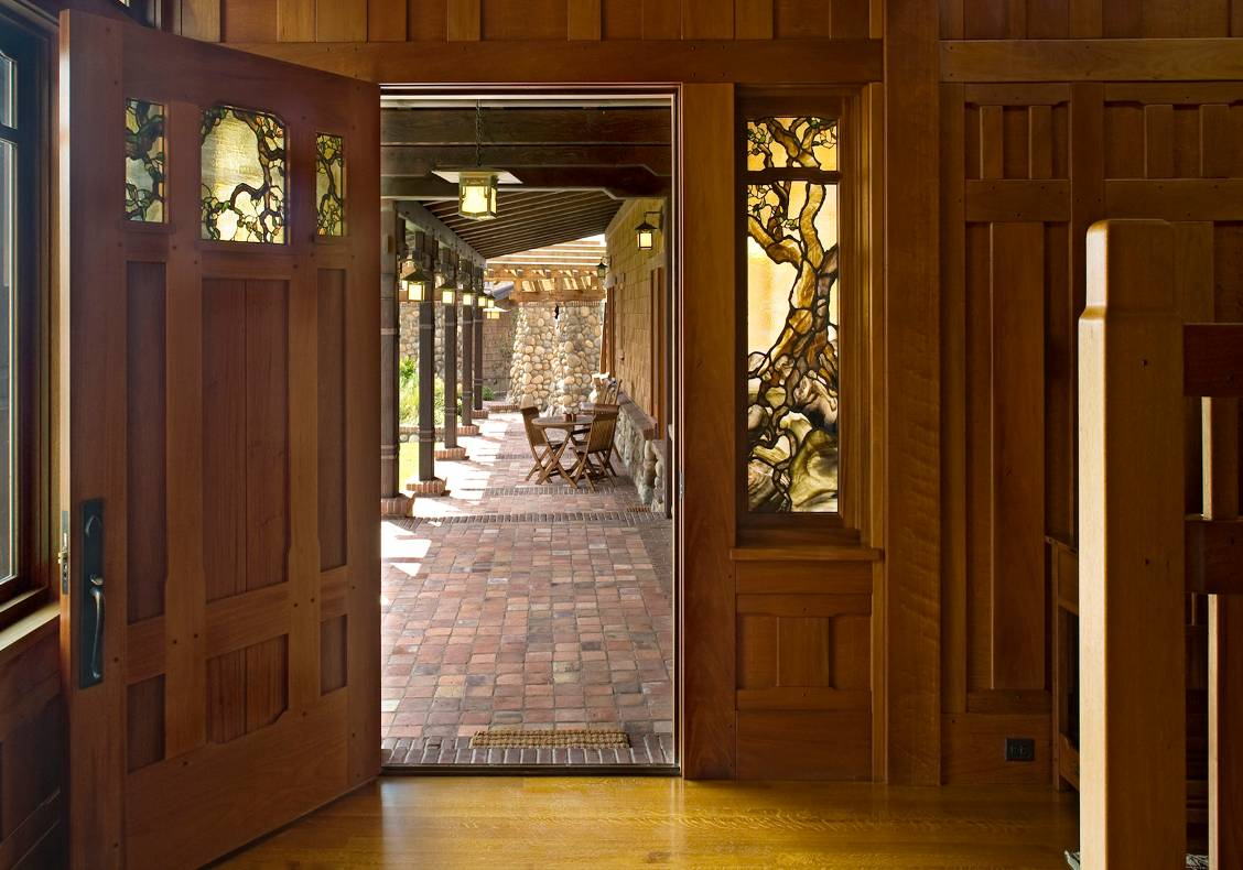 Fiddleback mahogany paneling and frames gives the entry hall a richness.  The stair is lit with clearstory windows which bath the space in natural light.