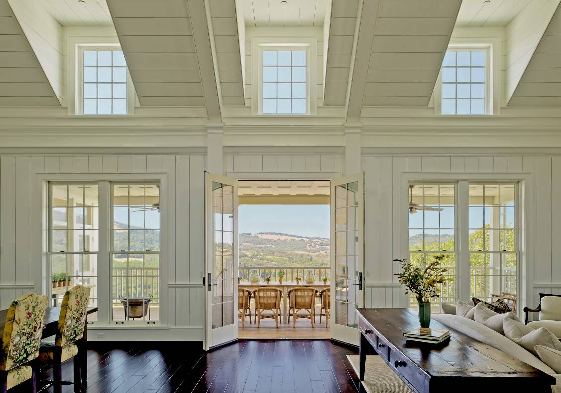 Looking out on axis through the living room and covered porch is a spectacular view of Bennett Valley.