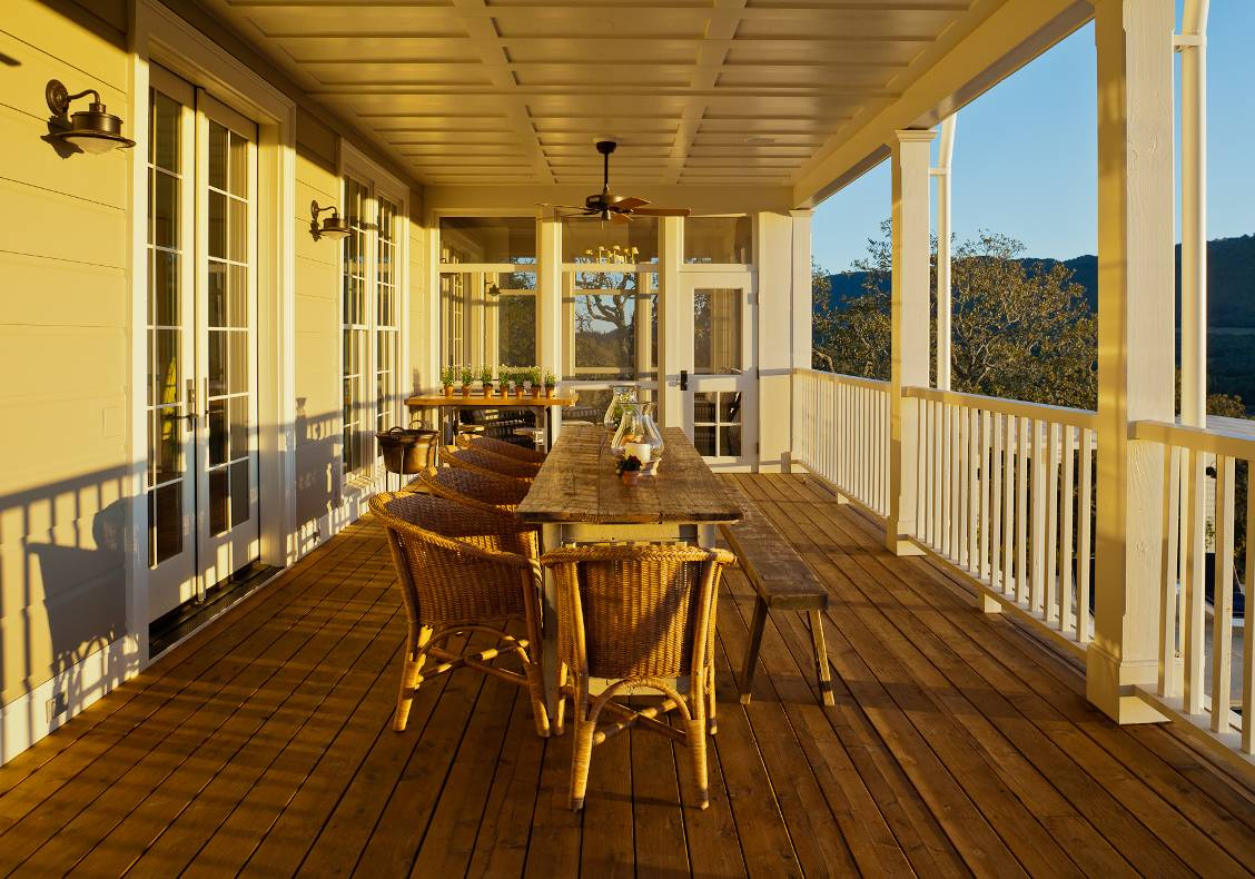 A screened dining porch opens out to the western view from the kitchen.
