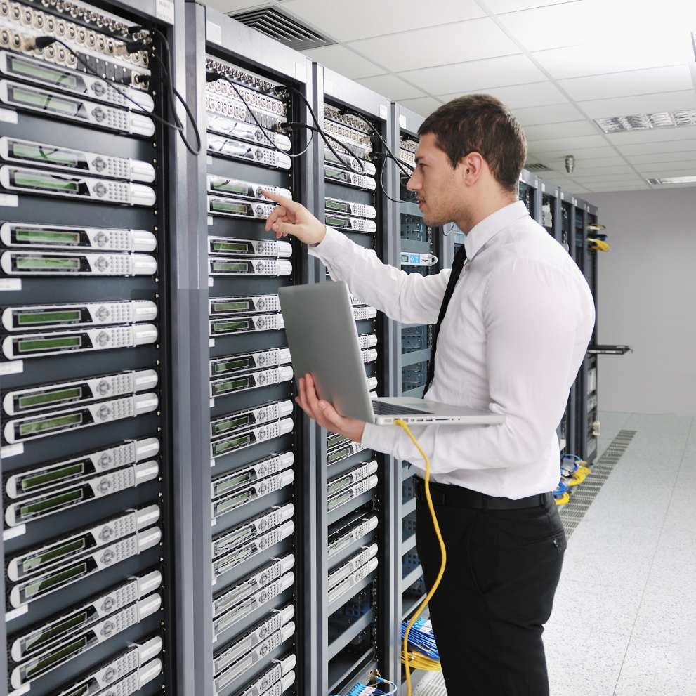 A Computer Networking tech makes sure a server farm is running smoothly
