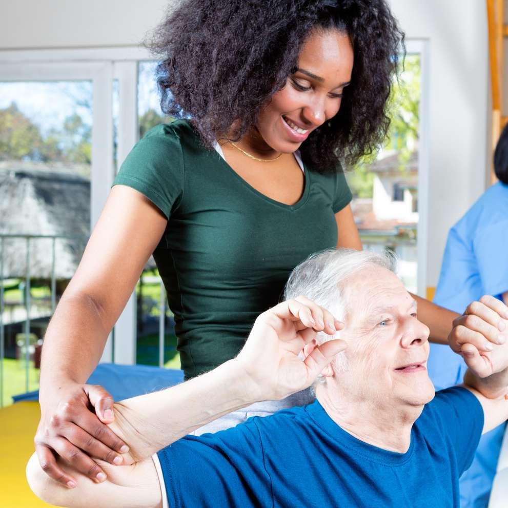 A Rehabilitation Technician helps restore an elderly patient's flexibility and strength