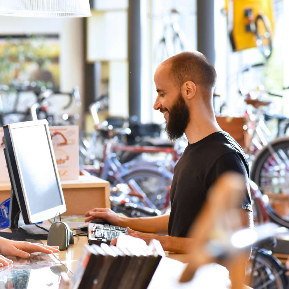 A Retail Sales specialist assists a customer at a bicycle store