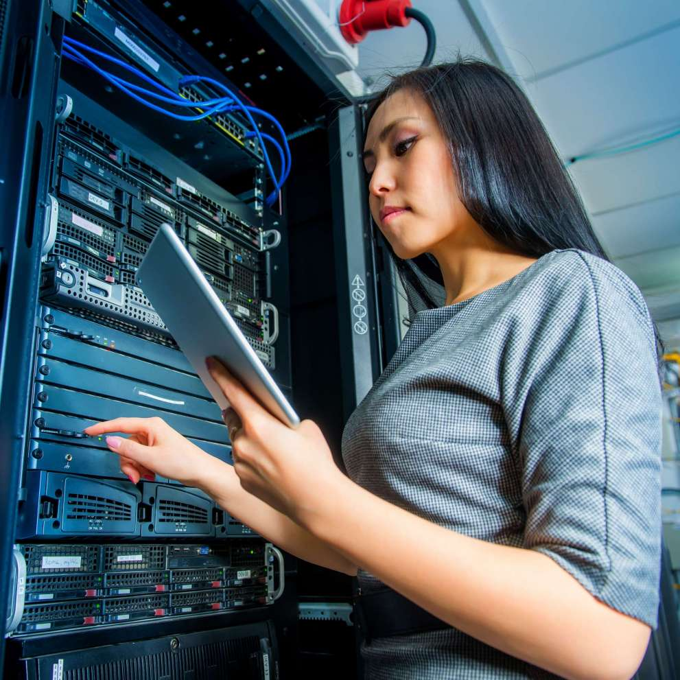 A Computer System Administrator checks the performance of a server stack.