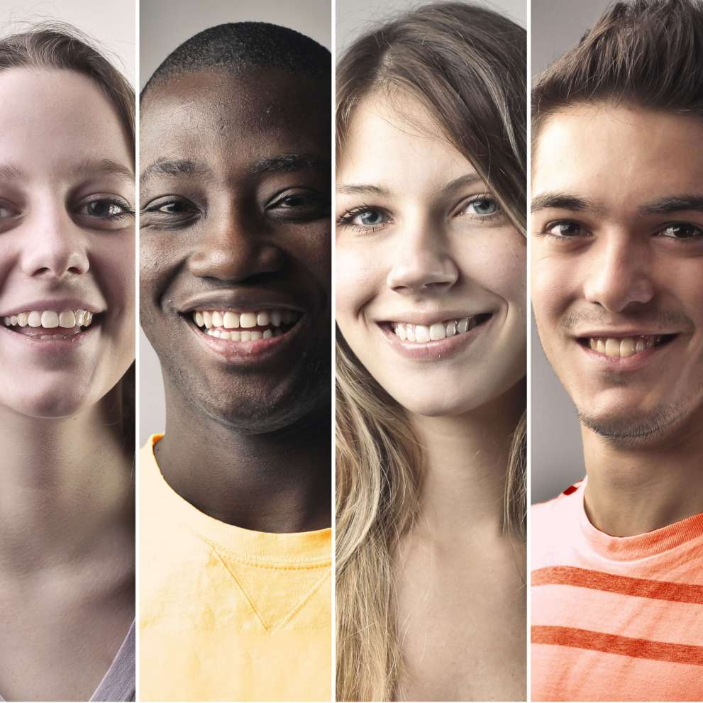 The smiling, diverse faces of six young students