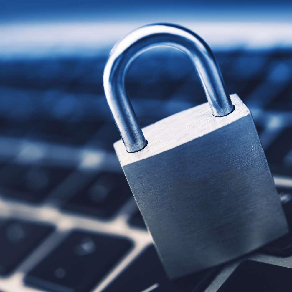 locked padlock on keyboard