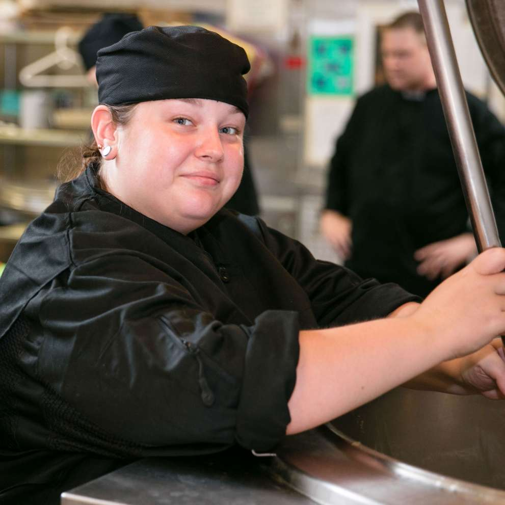 Advanced Culinary Arts student works in the kitchen