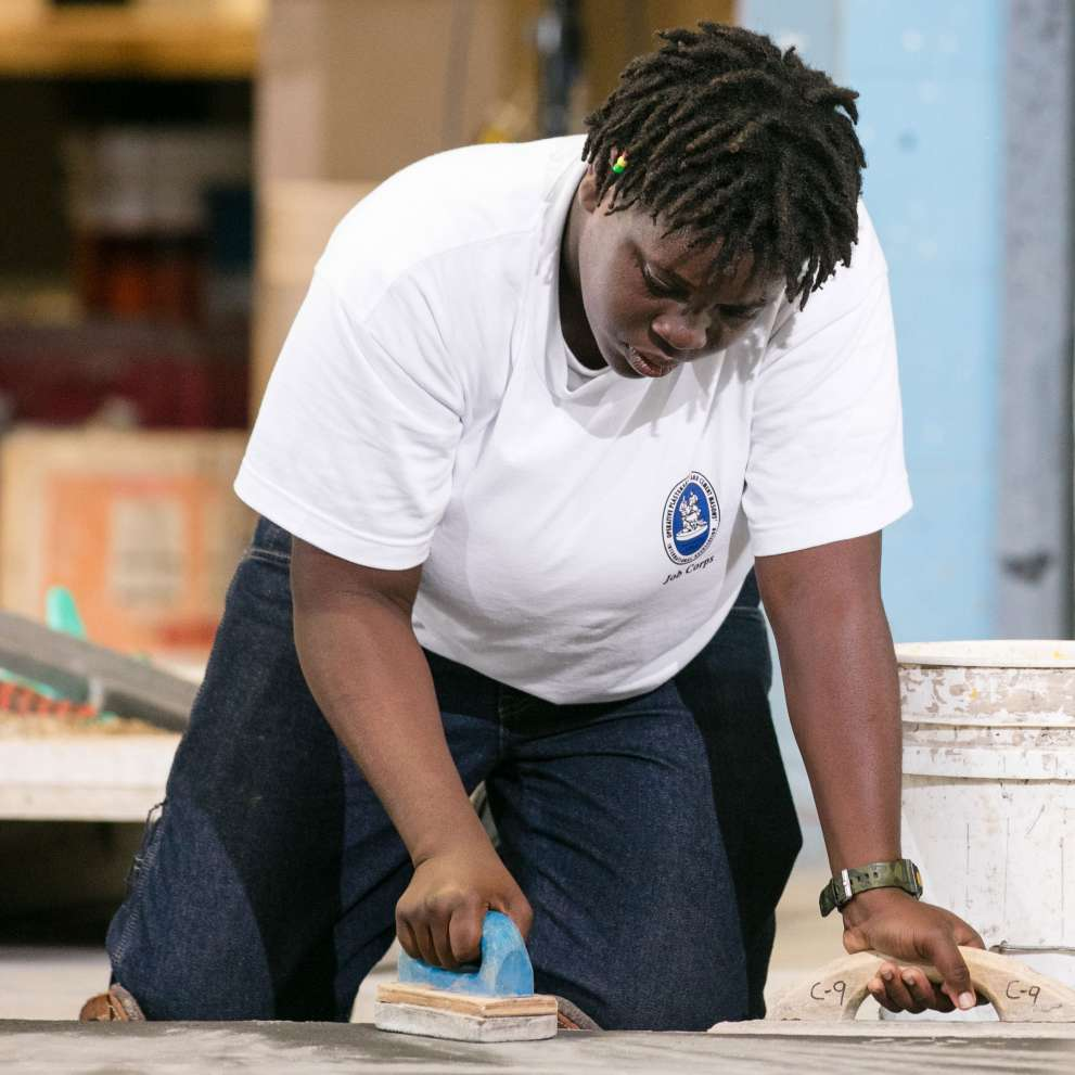 Cement masonry job corps cement masonry students smoothing a floor dailygadgetfo Gallery