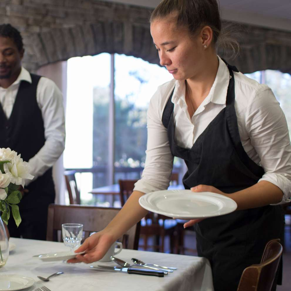 Hotel students setting a table