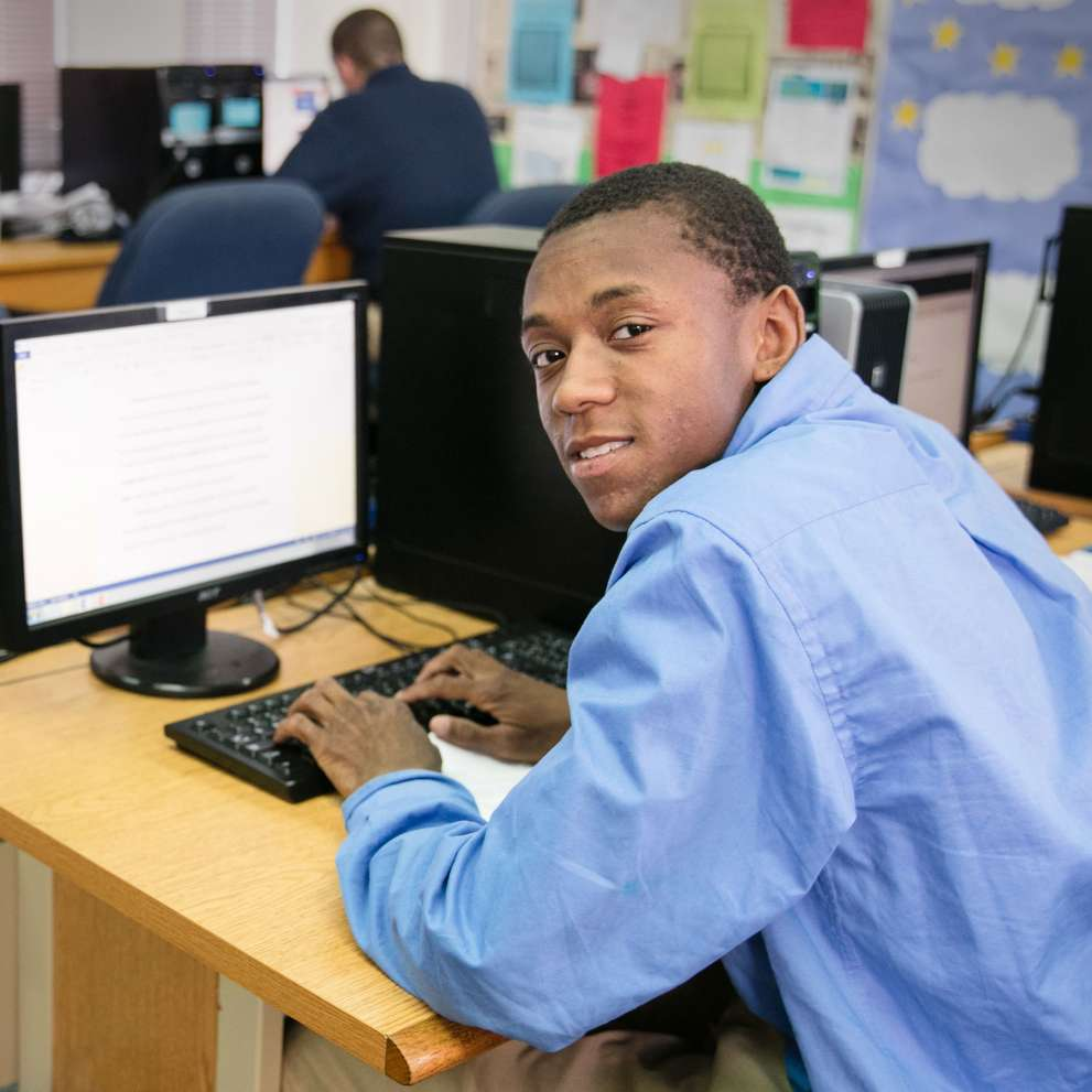 Office admin student working in a computer lab