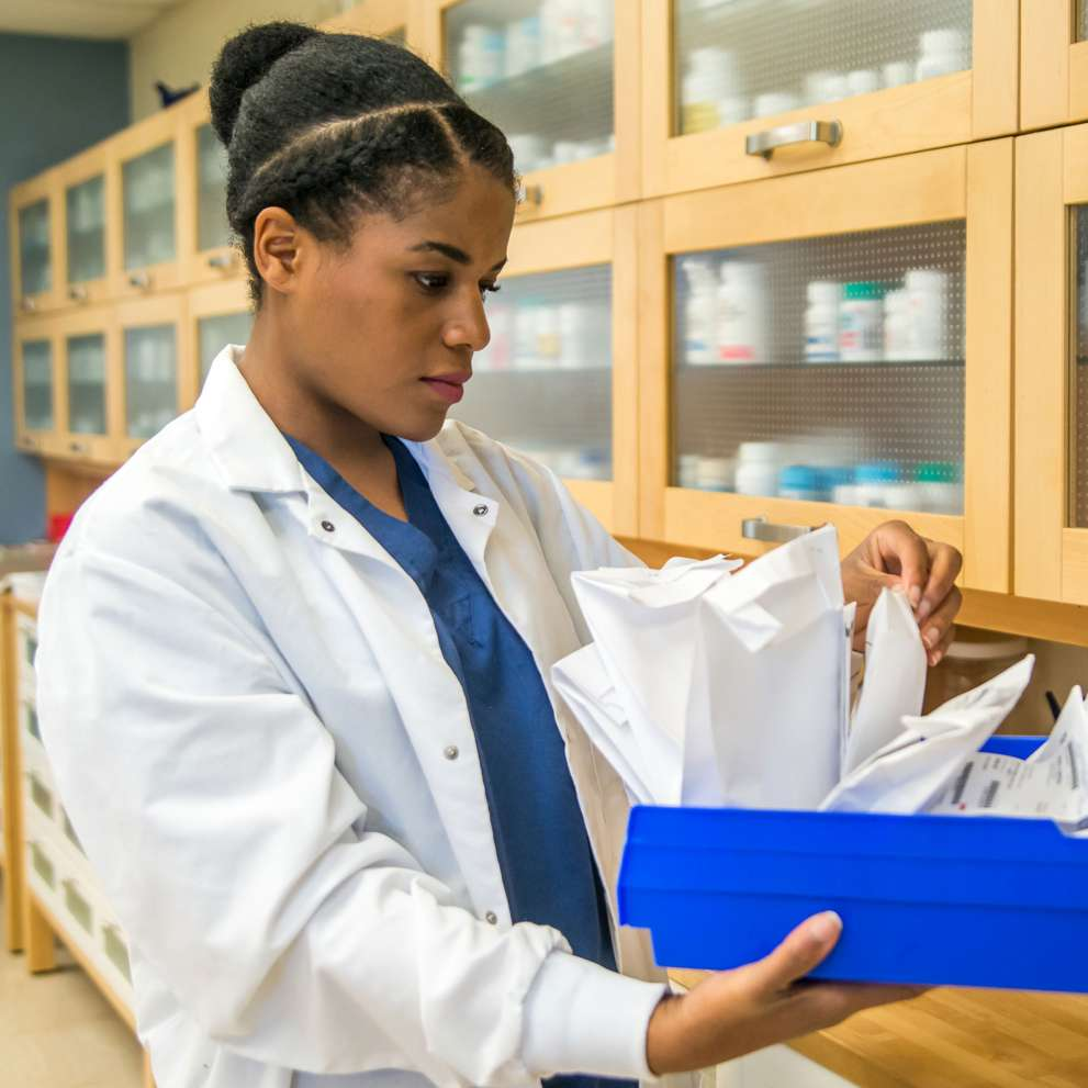 Pharmacy Technician student looking for a patient's prescription