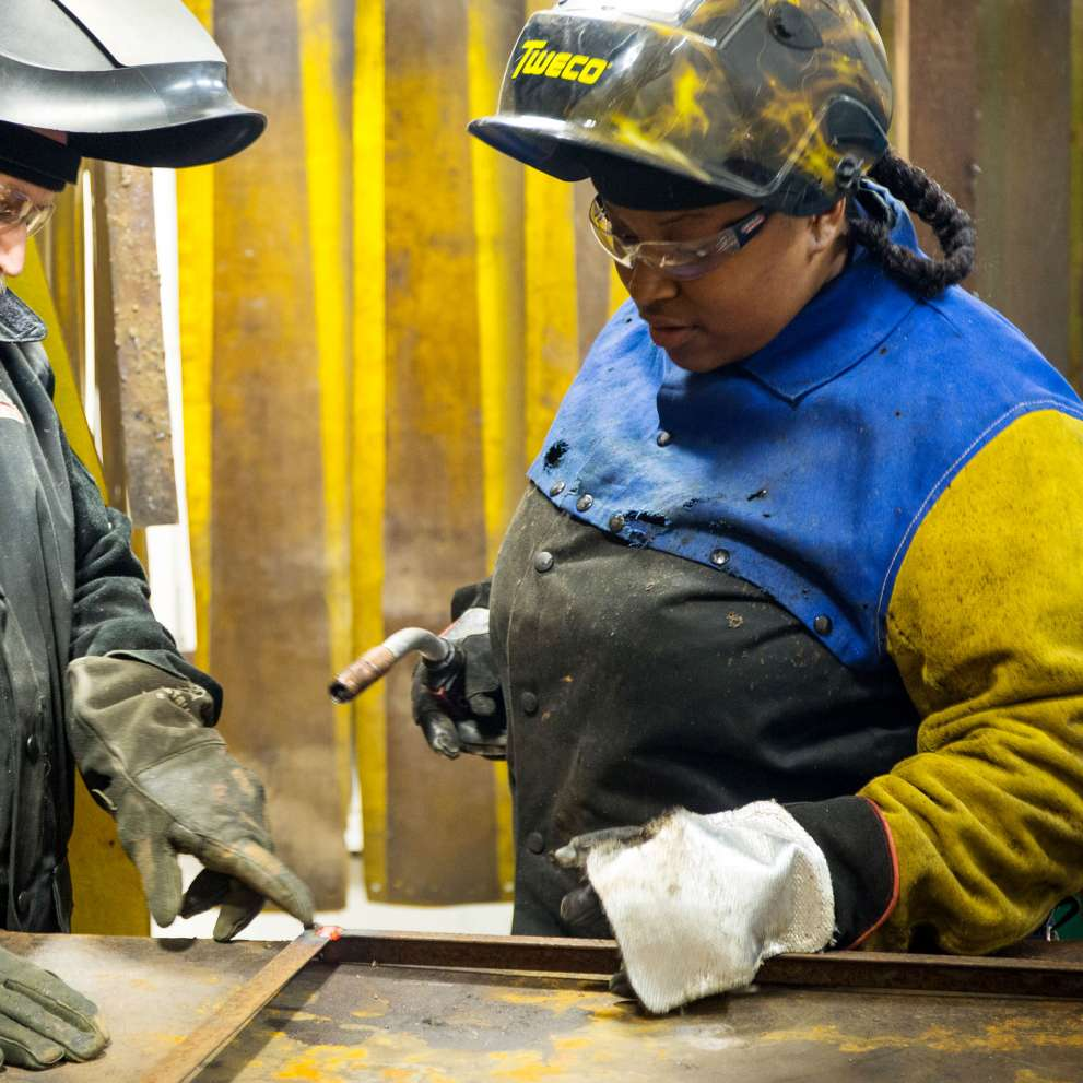Welding student receives instruction