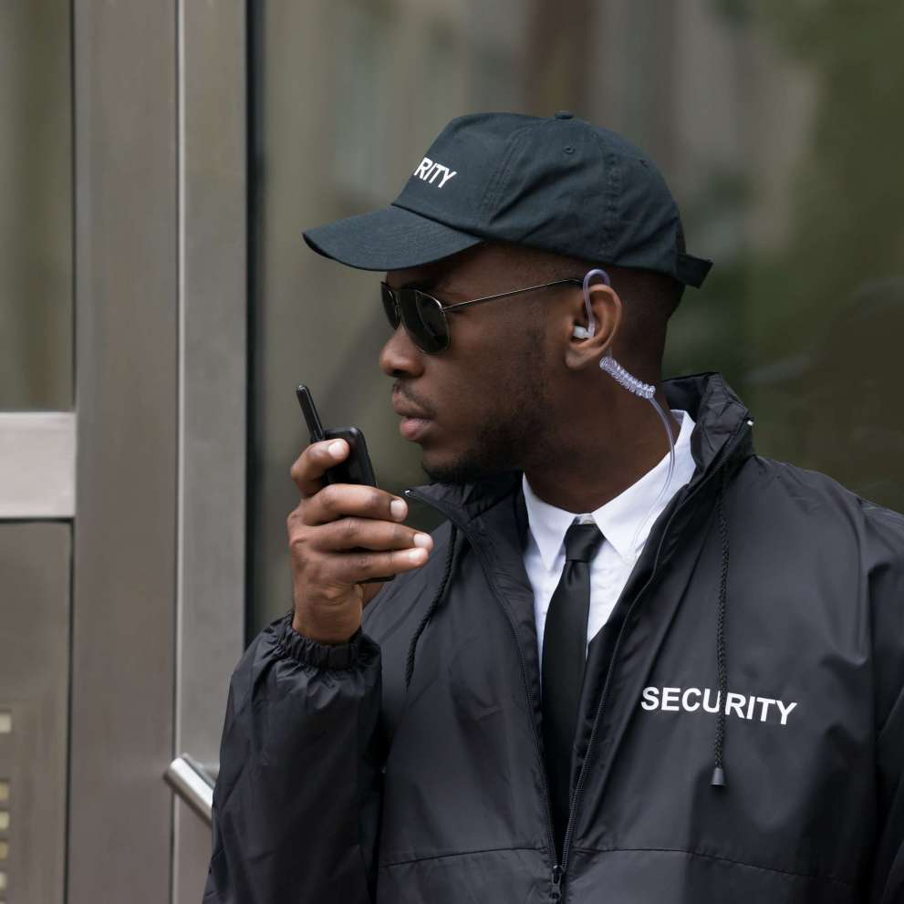 Security guard speaking into a radio