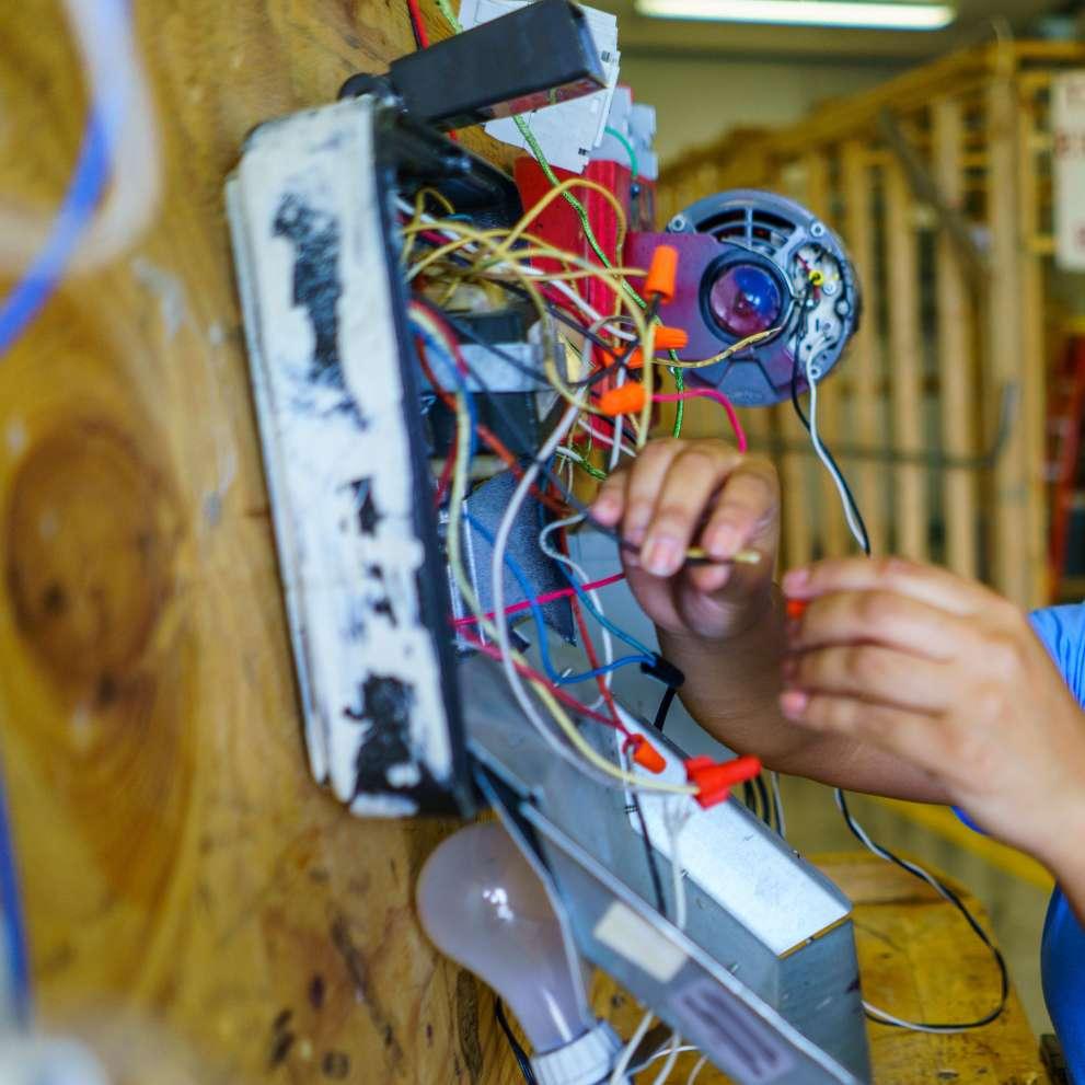 An electrician checks wiring