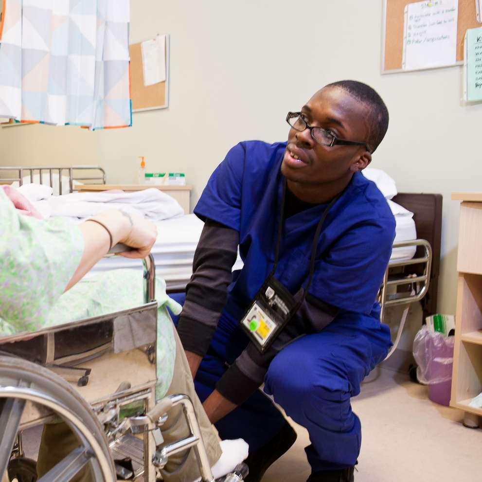 A Rehabilitation Technician assists a patient.