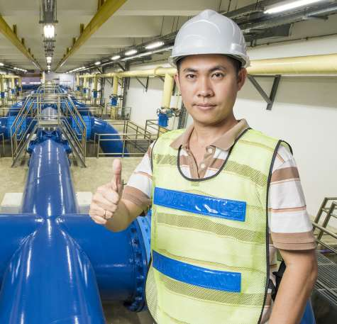A Wastewater Management worker gives the all-clear at the treatment plant