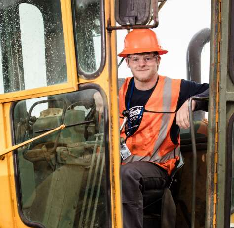 A Heavy Equipment Operator at work at a construction site.
