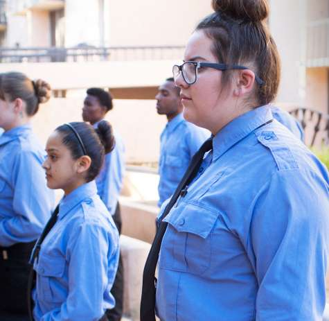 Security students standing in at attention in courtyard