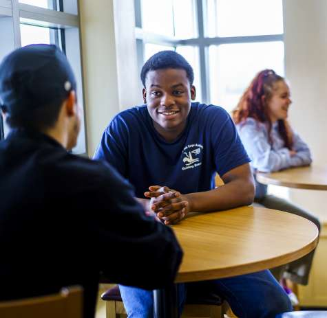Job Corps students sitting at tables in common area