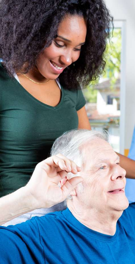 A Rehabilitation Technician helps restore an elderly patient's flexibility and strength