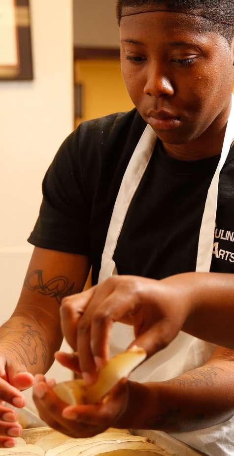 Culinary Arts students cut potatoes