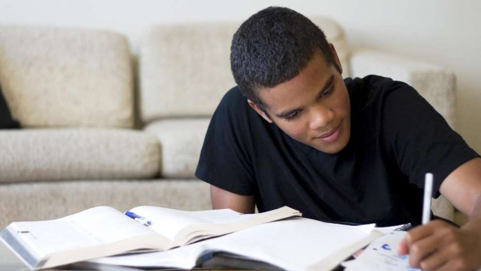 A Job Corps student studies hard for an upcoming exam.