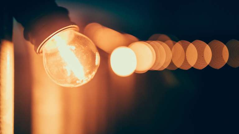 line of lit lightbulbs
