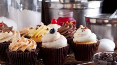 An array of cupcakes sit on display waiting to be eaten