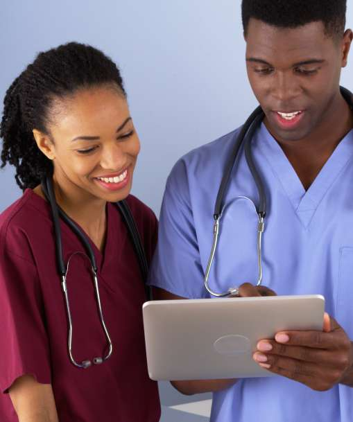 An Advanced Licensed Practical Nurse looks at the patient list on a tablet PC