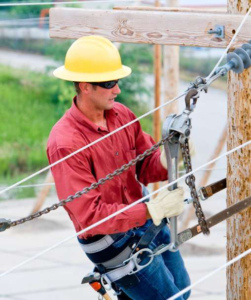 An Advanced Electrical technician works on power lines