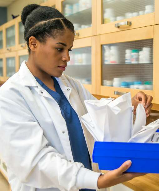 Pharmacy Technician student looking for a patient's prescription
