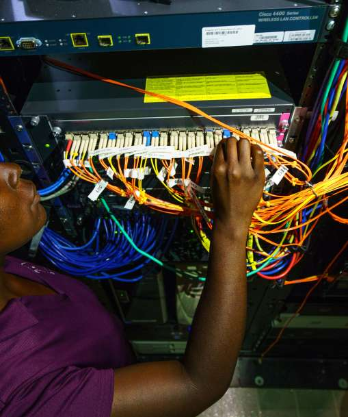 A computer system administrator checks a network connection