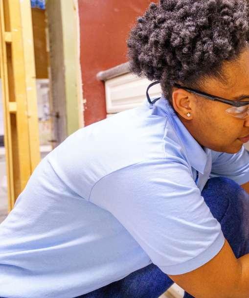 A Job Corps student performs a plumbing repair