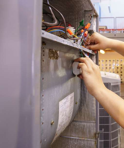 A Stationary Engineer works on equipment in an industrial setting.