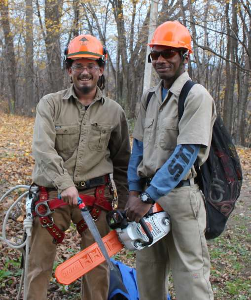 Two urban forestry students holding pruning equipment