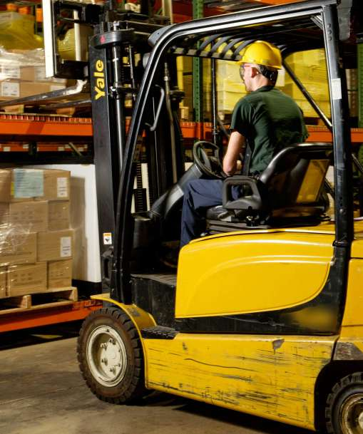 A Material and Distribution Operations worker moves goods with a forklift.