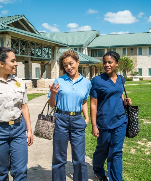 Job Corps students walking on campus