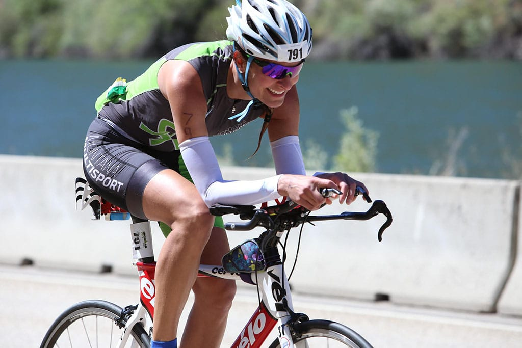 Montana Multisport Triathlon: Milica McDowell Ironman 70.3 Boise on a bike in a Montana Multisport tri kit
