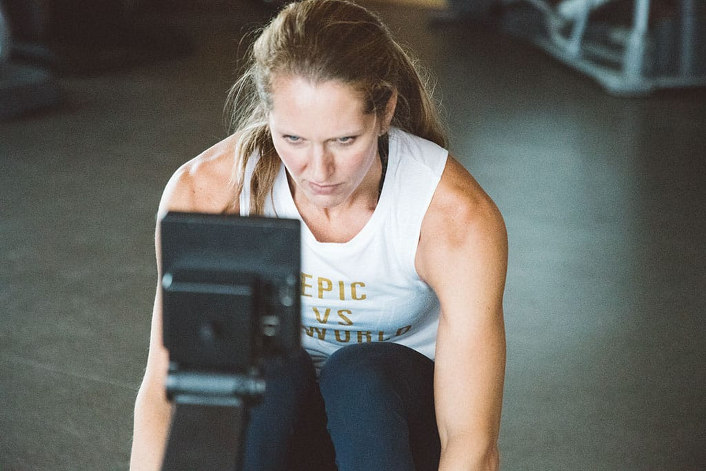 Female rowing wearing an Epic vs The World Tank