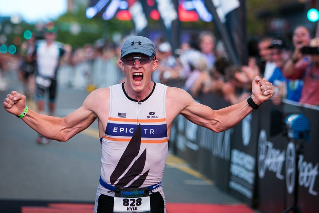 Male wearing an Epic Tri jersey finishing Ironman Coeur d'Alene