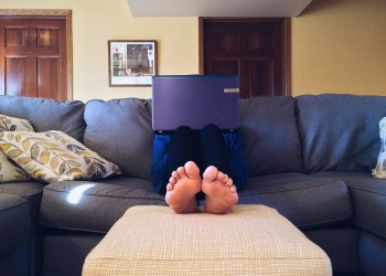 person-on-couch-with-laptop-home-to-work-350-250