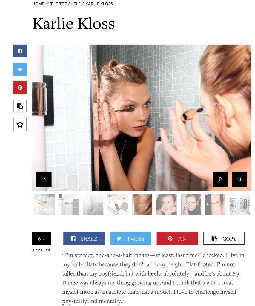 Karlie Kloss looking in the mirror