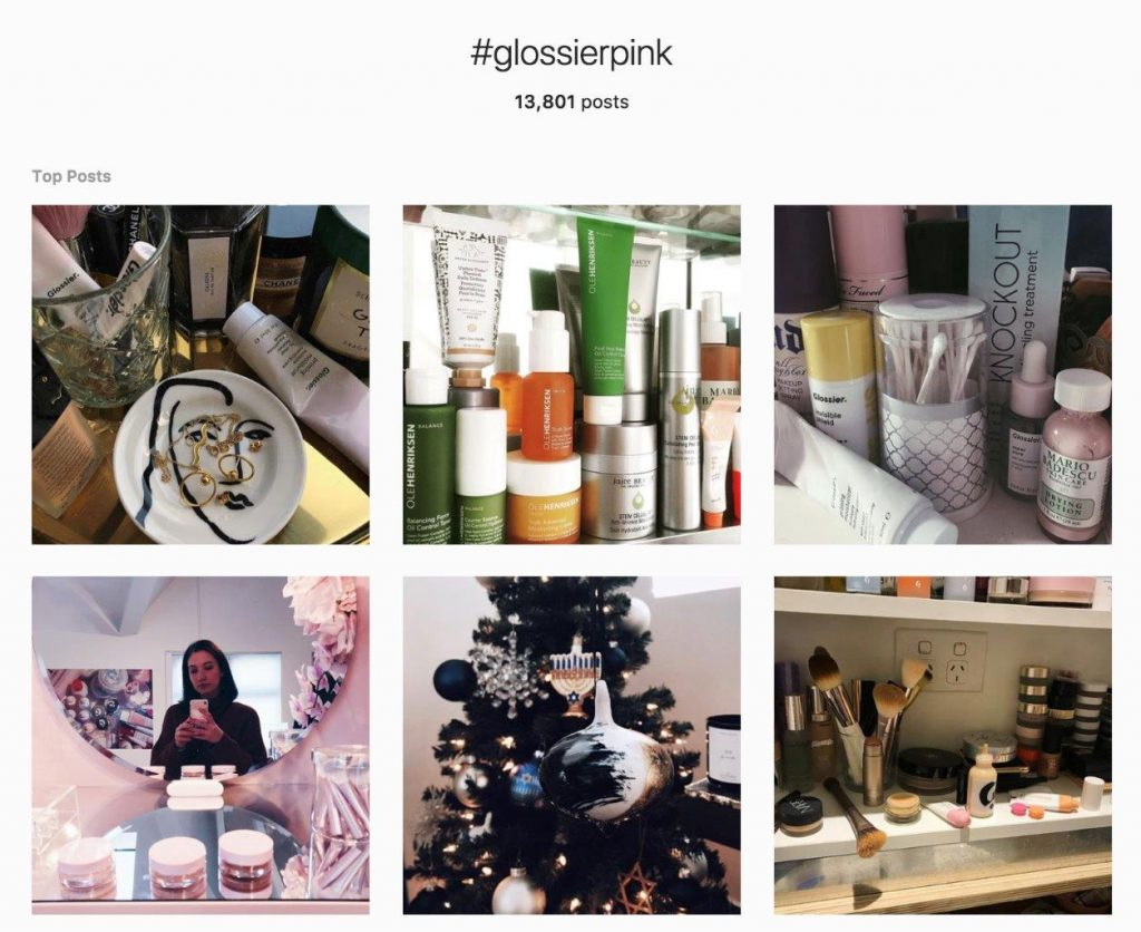Instagram feed with fan photos of Glossier pink color