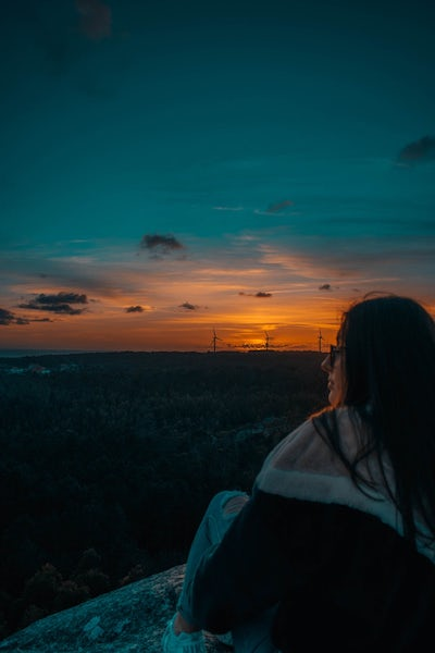 Girl Sitting Watching Sunset