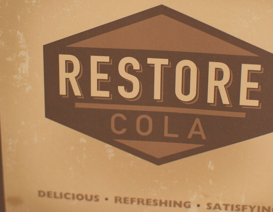 Front Detail of the Restore Cola bottle carrier package done by Kevin Dench